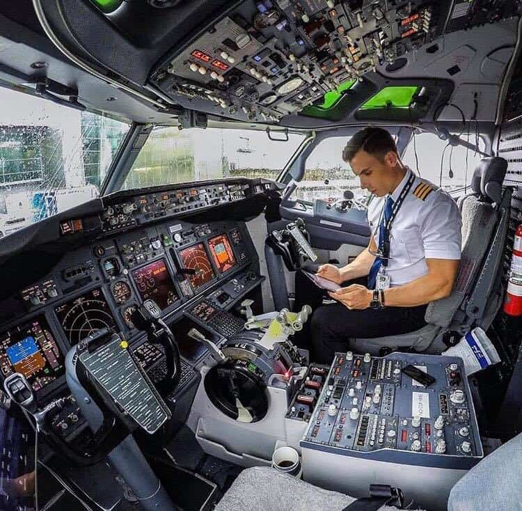 Pilot checking his flight planner